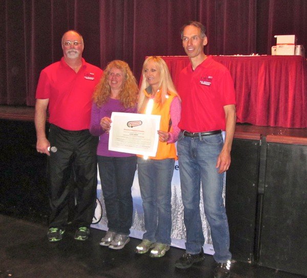 A special award was presented at the Tower Theatre before the individual awards were given.  Snowshoe Magazine sponsors an award for Snowshoe Person of the Year in memory of Cindy Brockman, the first recipient of the award.  This year the award went to Laurie Lambert of Texas because she's always been a beacon for the sport, said Snowshoe Magazine editor Ryan Alford.  Unfortunately, Lambert was unable to make the trip this year so her good friends Andrea Kinzey-Wheeler of Colorado and Cecilia Muldoon-Walker of Florida accepted the award for her.