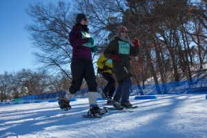 Abbey Engebretson, St Paul (11) runs the snowshoe road with Greg Schultz and Annemarie Peterson