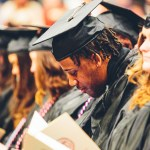 Graduates sitting at Commencement