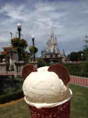 icecream cone with mickey ears in front of cinderella's castle
