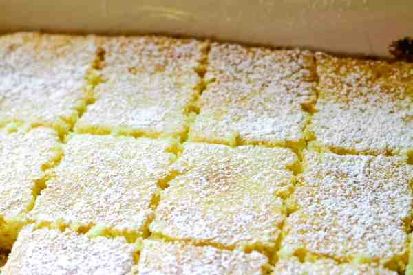 Lemon bars sprinkled with powdered sugar and cut into 12 pieces
