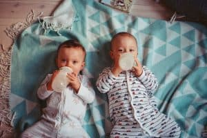 Two babies with bottles