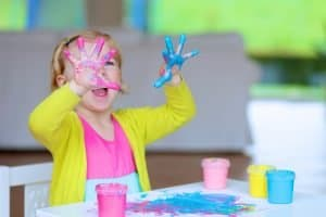 toddler with paint hands