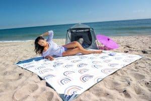 Woman on blanket on beach
