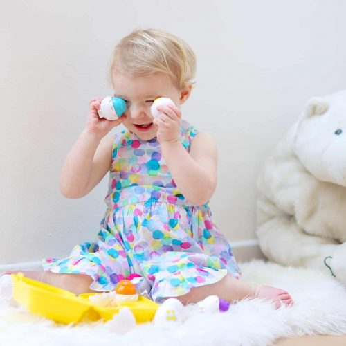 Little girl playing with Easter egs