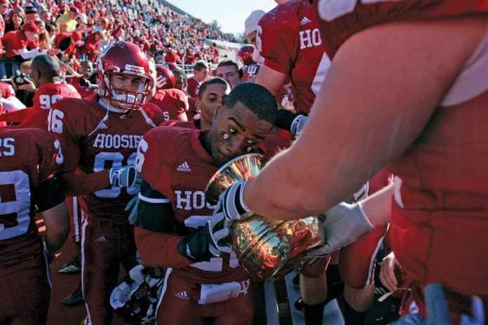 Then-sophomore safety Brandon Mosley prepares to spit into the Old Brass Spittoon after the Hoosiers' 46-21 victory against Michigan State in 2006 at Memorial Stadium.