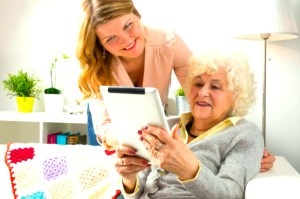 Photo of older adult looking at tablet