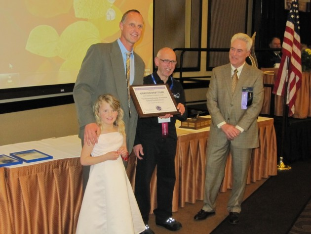 little-miss-boettger-assists-dad-at-awards-ceremony