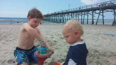 Working hard on the sand castle.