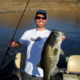 Angler holding an exciting catch, a 6 lb largemouth bass from Diamond Valley Lake, CA.