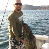 An angler with an expression of disbelief, holding the largest leopard grouper he had seen to date. Picture taken in the Midriff region of the Sea of Cortez.