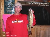 Angler wearing UCSB shirt and holding a walleye taken from Perrault Lake, Ontario.
