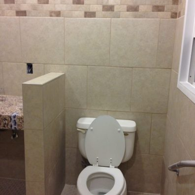 A photo of a toilet bowl taken in the bathroom