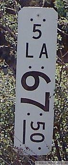 This milepost was found near Whitaker Summit on old US 99. US 99 was gone legislatively in 1964 so Route 5 took over the numbering here. That is why it shows the mileage for I-5.