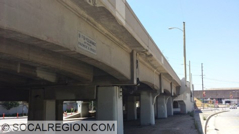 Concrete approaches with a painted clearance sign.
