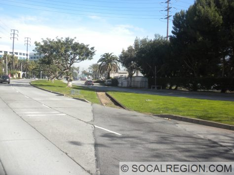 Expo Line crossing Olympic. Note the gutters on the rails in the median.