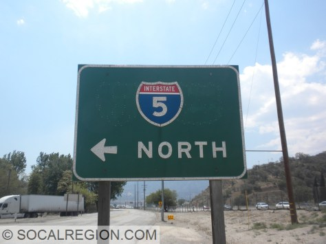 1965 signage with a removed US 99 shield. The I-5 shield was to the left and US 99 to the right.