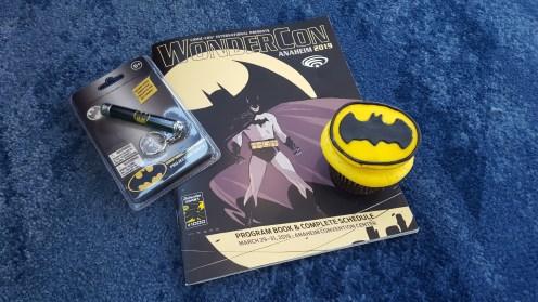 Batman celebrates his 80th birthday by sharing bat signal lights and cupcakes!