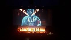 Darth Vader visits the Lightsaber Guild during the Masquerade intermission.