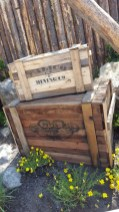 The name of the trading post up river is painted on the side of these crates at the ride's entrance