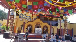 Seating in front of a live DJ in Fiesta Village