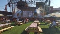 Calico Stage set up for plenty of seating in front of a giant screen broadcasting musical performances from Kirk and the Hillbillies as well as a live magic show
