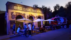 Additional seating in front of the Bird Cage Theatre while it remains dark