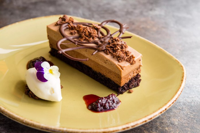 Try the Triple Chocolate Mousse Cake (berries chocolate tuile) for the ultimate sweet treat.