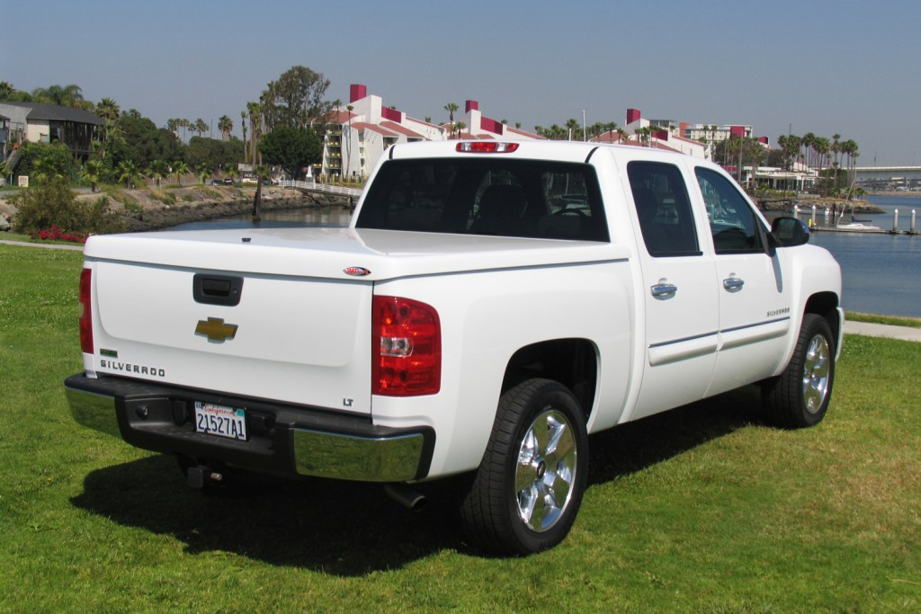 Marketing picture of the Snugtop RL fiberglass tonneau cover shown installed on a Chevrolet Silverado.