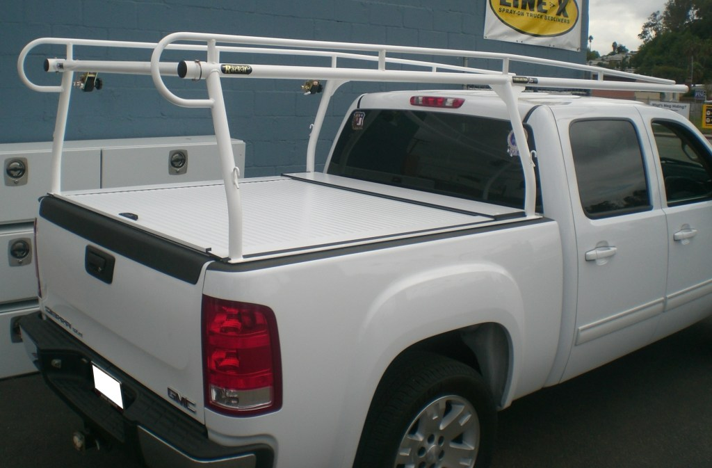 A white TruckCovers USA and a white powder coated rack it  lumber rack to match the vehicle.