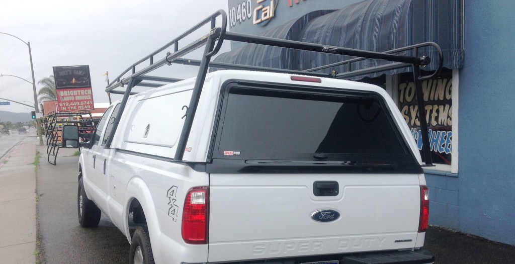 Snugtop Snugpro commercial camper shell w/ a 3000 Series Rack-It lumber rack to handle any job.