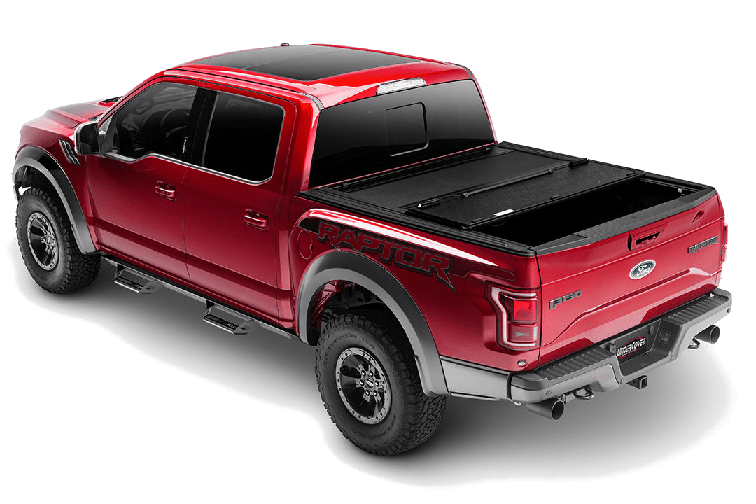 UnderCover ArmorFlex shown installed on a Ford Raptor with one panel opened.