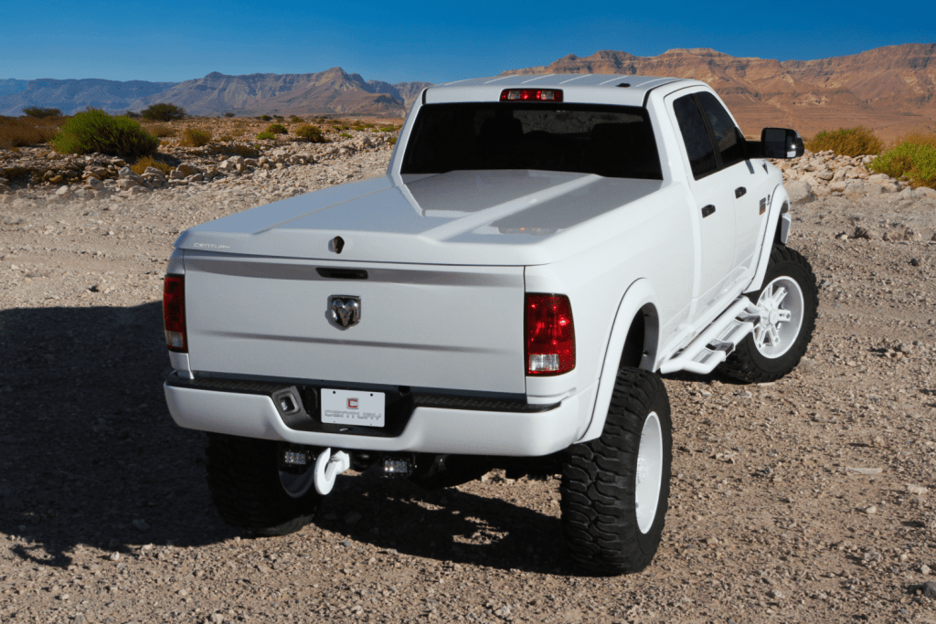 A white Century Silhouette shown installed on a Ram 1500 taken in a desert environment.