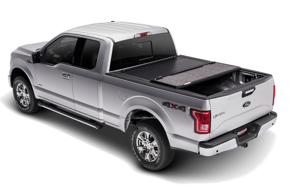 UnderCover Ultra Flex shown installed on a Ford F150 with one of the panels opened.