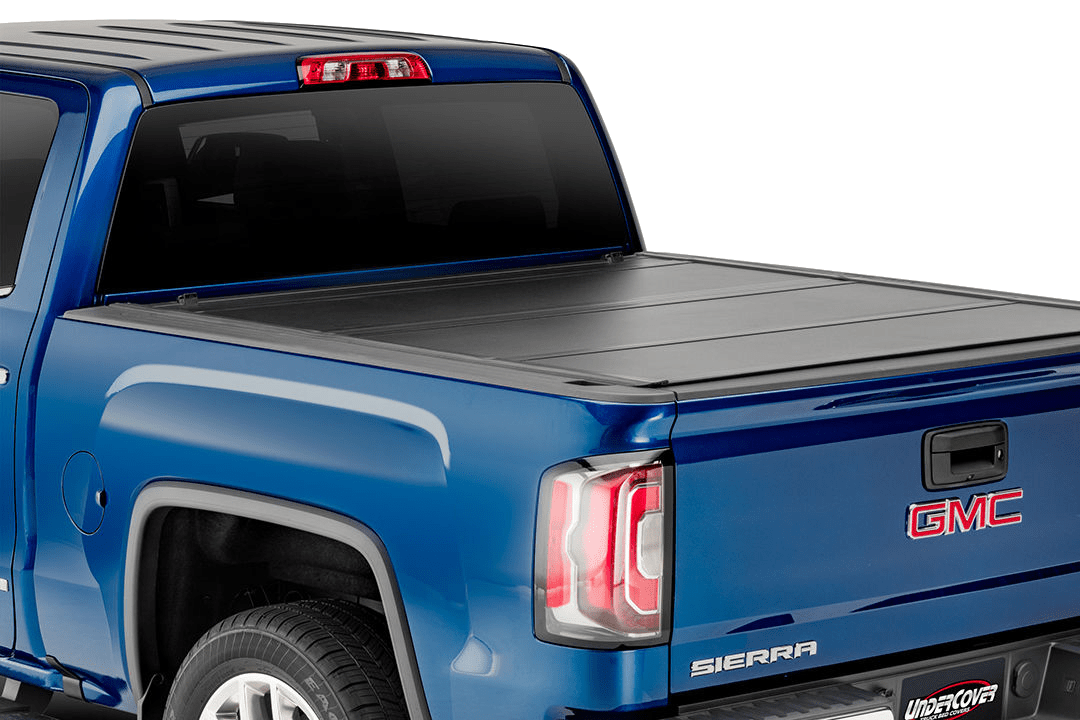 A close up of the Undercover Ultra Flex installed on a GMC Sierra with all of the panels closed.