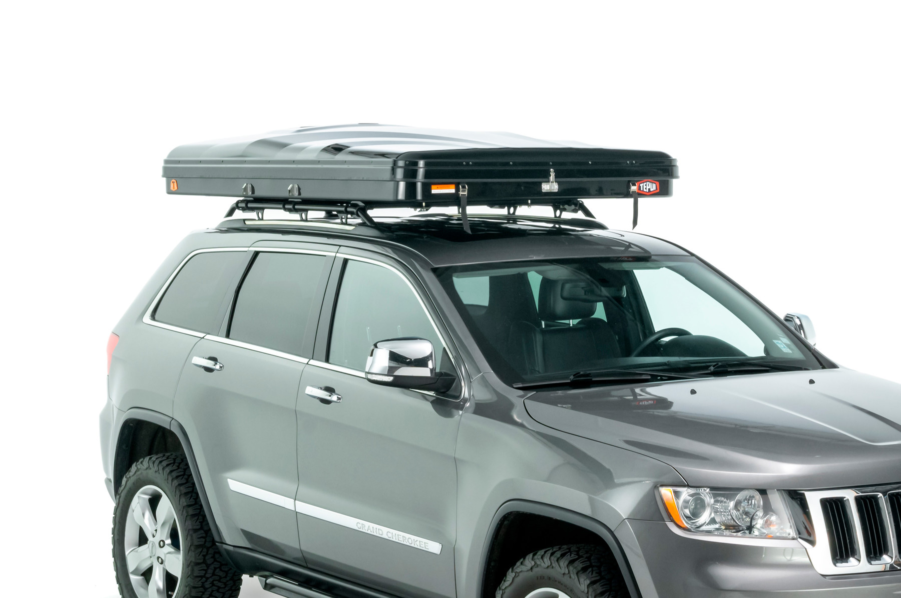 Tepui rooftop tent hybox in green shown installed on a vehicle.