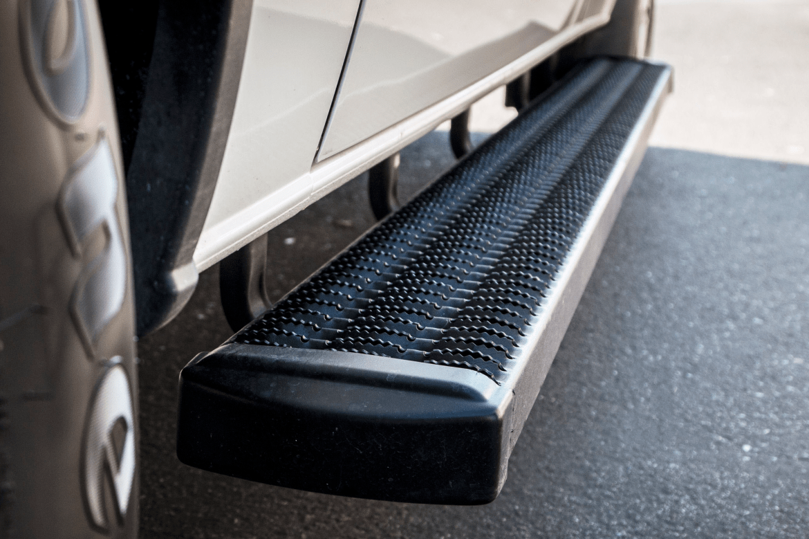 """Luverne grip step 7"""" step installed on a vehicle."""