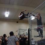 B-Boy shoves Kadillak off the Cage