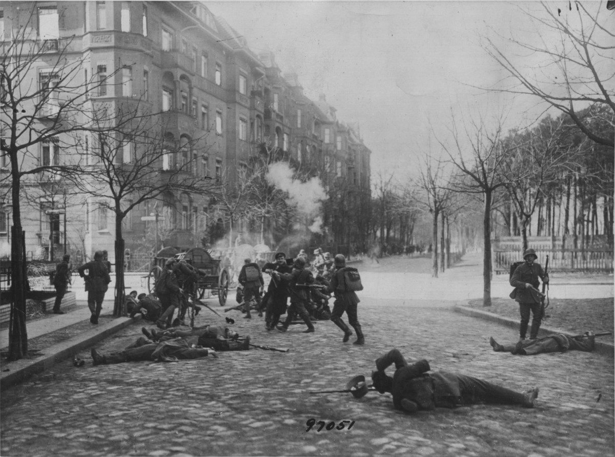 Street fights between government troops and revolutionary guards in Berlin, in September 1919. Date: 3 September 1919. Source: From an ebay auction. Photo: Not stated, stamped as Internal News Photos Copyright, not among Corbis website pictures. Public Domain.