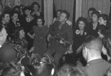 "Washington, D.C. Pete Seeger, noted folk singer, leading the crowd in ""When We March into Berlin"" at the opening of the Washington labor canteen, sponsored by the United Federal Workers of American, Congress of Industrial Organizations (CIO) CREATED/PUBLISHED: 1944 Feb. Photo: Horne, Joseph A. (Joseph Anthony), photographer. Source: Library of Congress Prints and Photographs Division Washington, D.C. 20540 hdl.loc.gov/loc.pnp/fsa.8d41980"