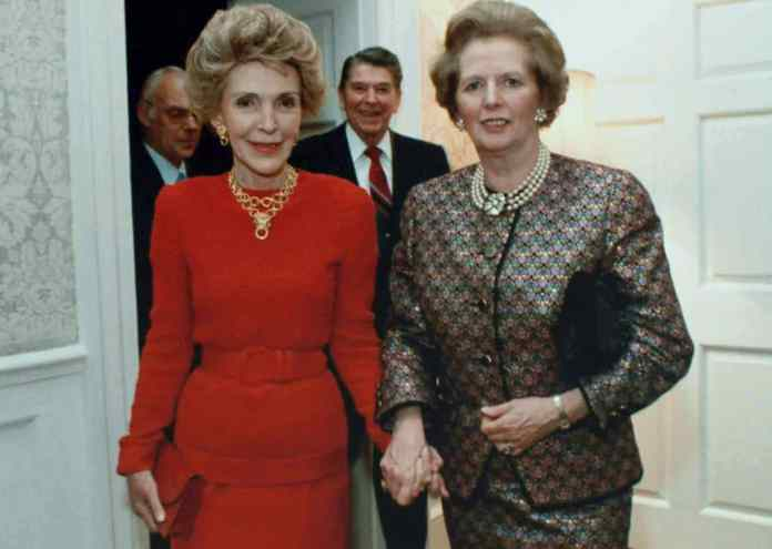 Margaret Thatcher and Nancy Reagan at 10 Downing Street. President Ronald Reagan is behind, in between the two, and Mr. Denis Thatcher is to Mr. Reagan's left. 2 June 1988. Photo: White House photo office, Source: http://www.margaretthatcher.org/multimedia/displaydocument.asp?docid=109673