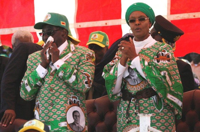Zimbabwe President Robert Mugabe (L) and his wife Grace at a rally at Chubuku stadium in Chitungwiza town about 35km south of Harare, July 16, 2013. Zimbabwe goes to the polls on July 31. (CC BY-SA 3.0)