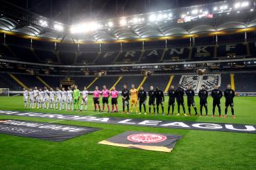 epa08290149 Frankfurt (R) and Basel players line up prior to the UEFA Europa League round of 16, first leg, soccer match between Eintracht Frankfurt and FC Basel in Frankfurt Main, Germany, 12 March 2020. The match takes place without spectators over the COVID-19 coronavirus threat. EPA-EFE/ARMANDO BABANI
