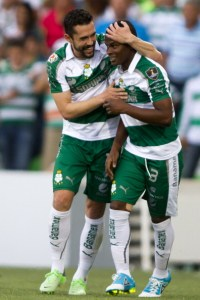 Santos's Hercules Gomez (L) and Darwin Quintero (R) celebratestheir first goal against Seattle Sounder during their CONCACAF Champions League first leg semi-final match in Torreón, Coahuila state on April 9, 2013. AFP PHOTO/VÍCTOR STRAFFON (Photo credit should read VICTOR STRAFFON/AFP/Getty Images)