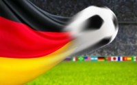 German flag morphing into soccer ball. Soccer field with international flags.