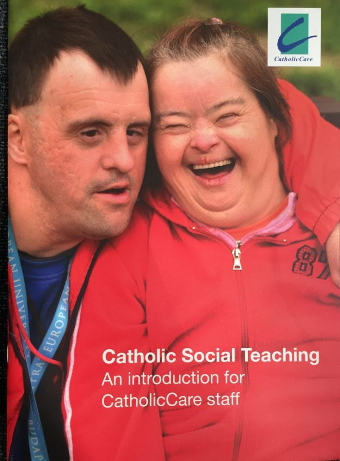 "Cover of ""Catholic Social Teaching: An introduction for CatholicCare Staff"" by Sandie Cornish. Photo of two smiling adults with disabilities."