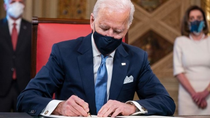 US President Joe Biden signs three documents after being sworn-in