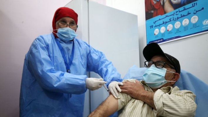 An Algerian person receives an injection of the Russian vaccine