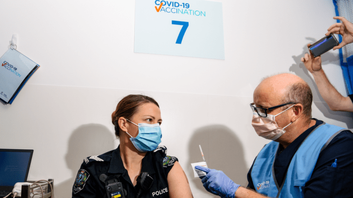 A police officer receives the Pfizer vaccine at a clinic in Adelaide