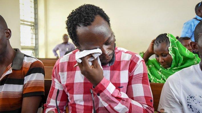 Detained Tanzanian journalist Erick Kabendera (C) in court in Dar es Salaam, Tanzania, on 2 January 2, 2020